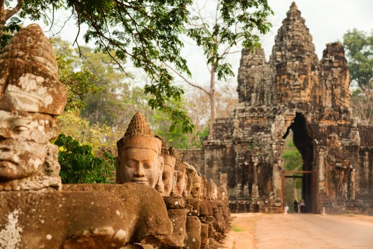 LOLEI TRAVEL – Cambodia - Faces at the entrance of Bayon Temple in Angkor Wat, Cambodia